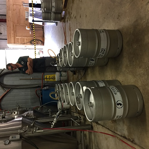Our guy Andrew, kegging Concrete Ship.