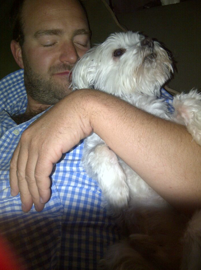 CMBC President Ryan Krill cuddles up with Max.