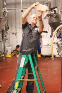 Al Buck of East Coast Yeast adds yeast to the brew