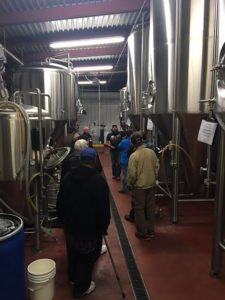 farmers-tour-the-brew-house-with-jimmy-valm-during-a-break-in-program-announcements